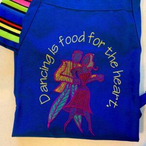 Shop North Dakota Dancing is food for the heart apron