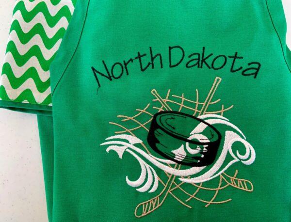 Shop North Dakota North Dakota Hockey Puck Apron