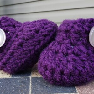 Shop North Dakota Purple baby booties with shiny pearl buttons 3-6 months