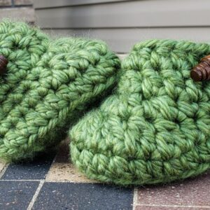 Shop North Dakota Green baby booties with brown wooden buttons 3-6 months old