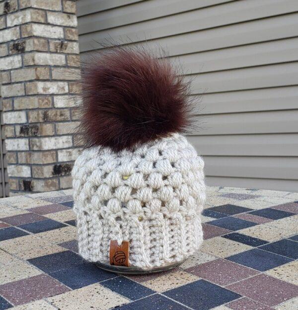 Shop North Dakota Light cream/tan hat with dark brown poof ball 0-3 months